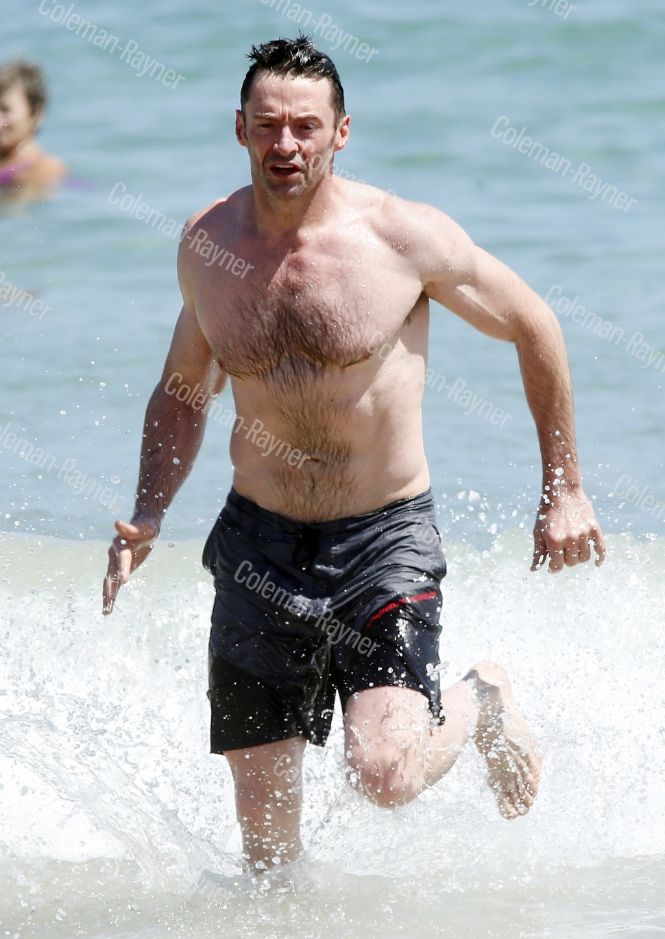 Hey, Muscles! Hugh Jackman flaunts his buff body in the Bondi Beach surf